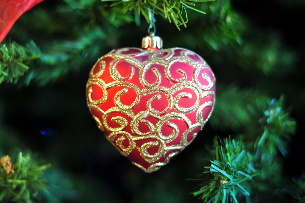 Pretty Red Heart Shaped Festive With Gold Swirl Patterns Hanging From Artificial Christmas Tree