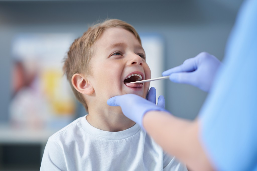 Portrait Of Adorable Little Boy Having Doctor's Appointment