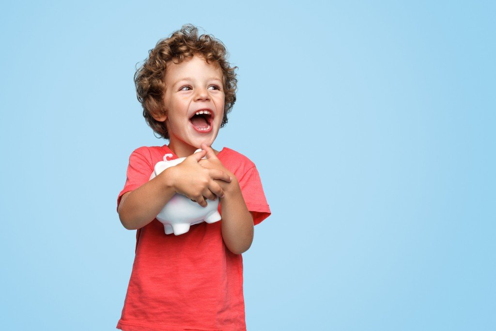 Excited Kid With Piggy Bank