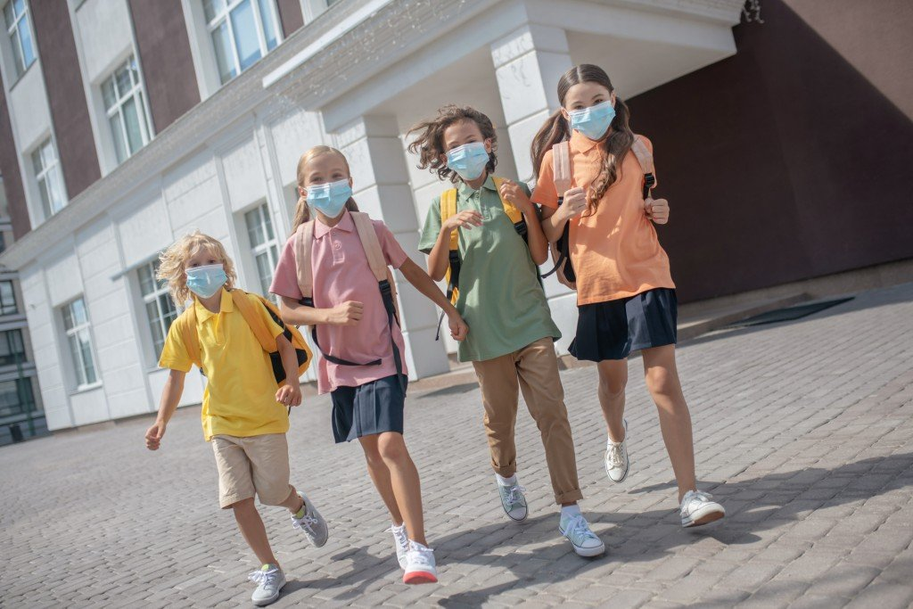 Schoolchildren In Protective Masks On Their Way Home After Lessons
