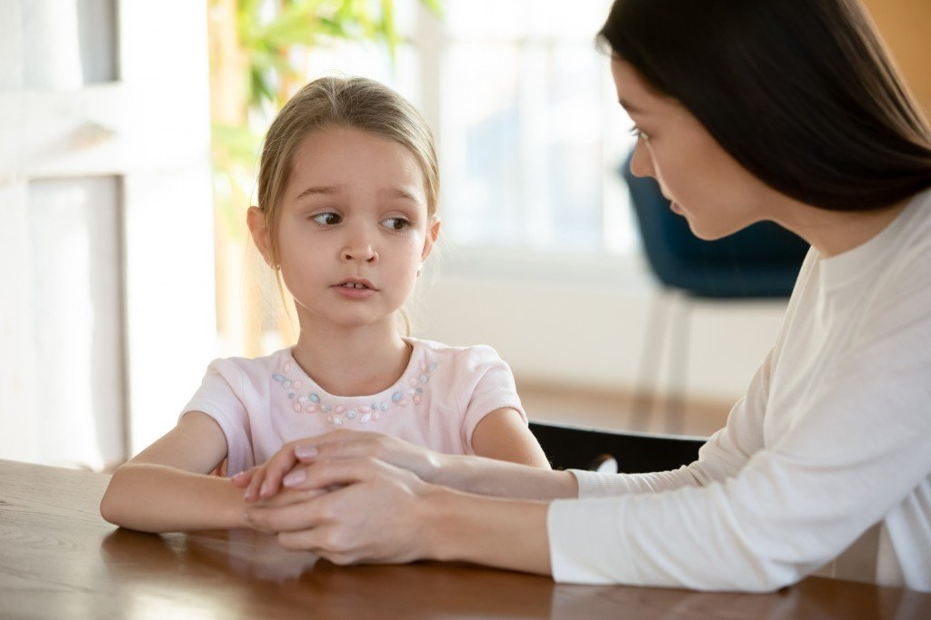 Unhappy Small Child Girl Sharing School Problems With Mom.