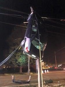 Car on utility pole original