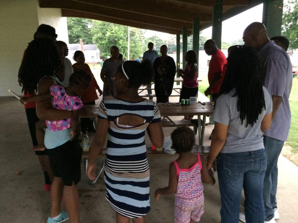 Group holds vigil to remember lives affected by police ...