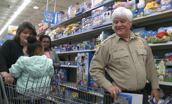 MILAN Tenn — Local law enforcement rallied together Thursday night to bring children holiday joy just in time for Christmas