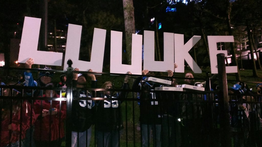 Panthers fans hold a 'Luuuke' sign for the teams arrival back to Charlotte.