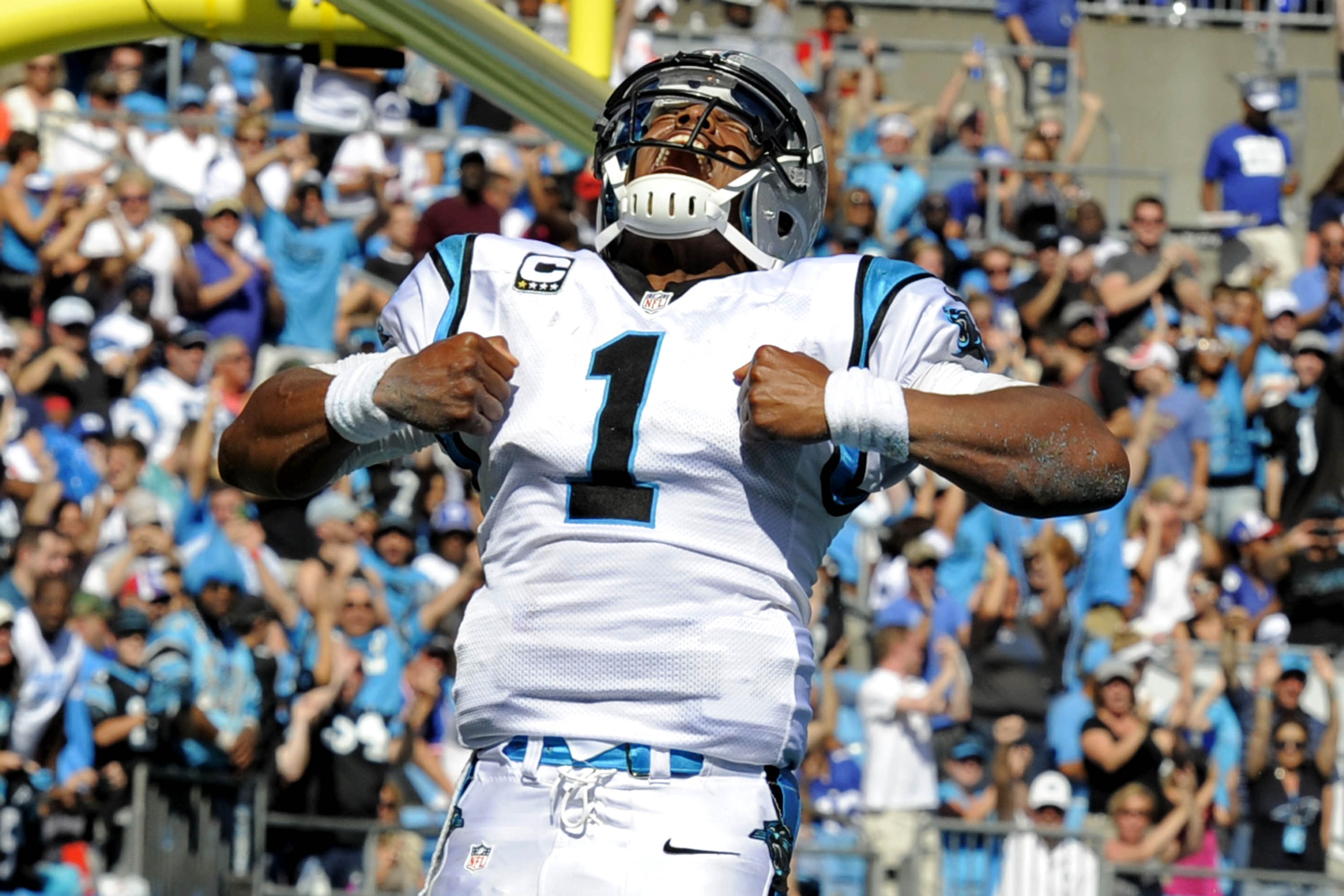 cc2cd4879ccf Carolina Panthers  Cam Newton (1) celebrates his touchdown run against the  New York
