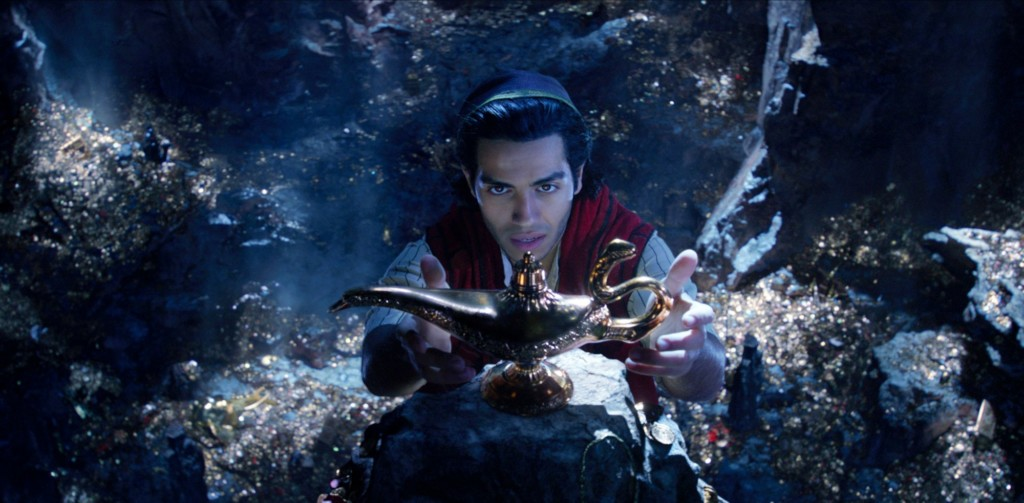 "This image released by Disney shows Mena Massoud as Aladdin in Disney's live-action adaptation of the 1992 animated classic ""Aladdin."""