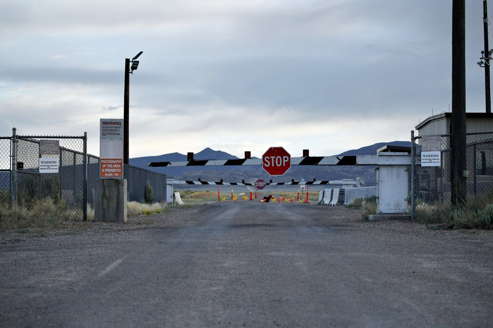 signs warn about trespassing at an entrance to the Nevada Test and Training Range near Area 51 outside of Rachel, Nev.