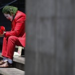 David Vazquez, A Street Performer Dressed As The Joker, Waits In Hopes Of Pedestrians Who Will Pay To Take Pictures With Him In Mexico City, March 23, 2020.