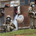 South African National Defense Forces Patrol The Men's Hostel In The Densely Populated Alexandra Township East Of Johannesburg, March 28, 2020