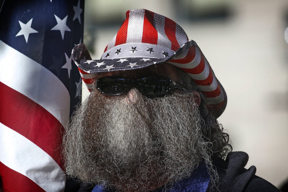 A Man Looks On During The Utah Business Revival Rally