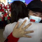 A Medical Worker From China's Jilin Province Reacts As She Prepares To Return Home At Wuhan Tianhe International Airport In Wuhan In Central China's Hubei Province, April 8, 2020