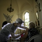 A Medical Worker Injects An Elderly Woman With A Flu Vaccine Inside A Church As Part Of A Government Vaccination Campaign, In Buenos Aires, Argentina,
