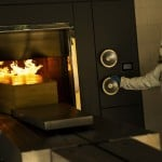 A Worker Moves A Casket Of A Covid 19 Deceased Into The Crematorium Oven At The Pontes Crematorium And Funeral Center In Lommel, Belgium