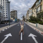An Israeli Man Stands On His Hands On An Empty Road During A Lockdown Following Government Measures To Help Stop The Spread Of The Coronavirus, In Tel Aviv, Israel