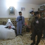 Police Officers Arrive To Escort Ahmed Khaled Al Kaabi And His Bride Ruqaya Rahim During Their Wedding In Najaf, Iraq