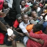 Residents Desperate For A Planned Distribution Of Food For Those Suffering Under Kenya's Coronavirus Related Movement Restrictions Push Through A Gate And Create A Stampede,