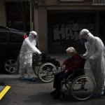 Volunteer Of The Spanish Ngo Open Arms Pushes In A Wheelchair An Elderly Resident Of A Nursing Home With Coronavirus Symptoms To A Hospital In Barcelona