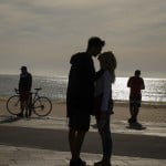 A Couble Kiss In Front Of The Sea In Barcelona, Spain, Saturday, May 2,