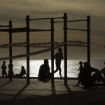 People Exercises In A Seafront Promenade In Barcelona, Spain