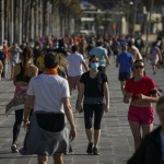 People Exercises In A Seafront Promenade In This Photo Taken With A Telephoto Lens In Barcelona, Spain