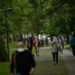 People Wearing Face Masks To Prevent The Spread Of Coronavirus Walk Along Vuelta Del Castillo Park, In Pamplona,