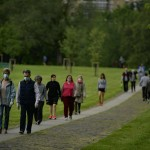 People Wearing Face Masks To Protect Against Coronavirus Exercise Along Vuelta Del Castillo Park, In Pamplona