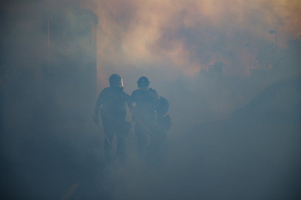 Police Officers Walk Through A Cloud Of Tear Gas, Thursday, May 28