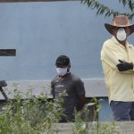 Residents, Wearing Protective Face Masks And Gloves, Watch As Journalists Arrive In Their Neighborhood To Confirm The Death Of A Neighbor Who Allegedly Died Of The New Coronavirus
