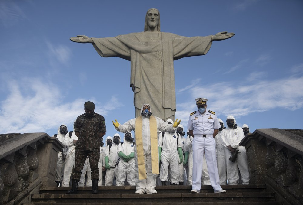 Catholic Priest Omar, Center, Leads A Prayer As Soldiers Pause From Disinfecting The Christ The Redeemer Area, Currently Closed During The New Coronavirus Pandemic In Rio De Janeiro, Brazil,