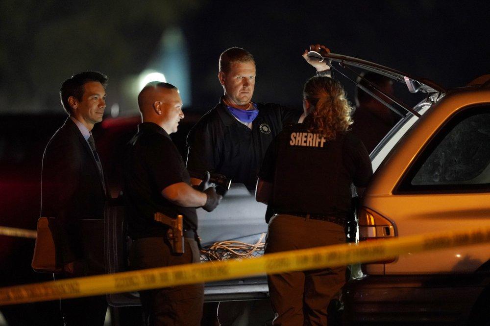 Law Enforcement Officials Search A Vehicle, Thursday