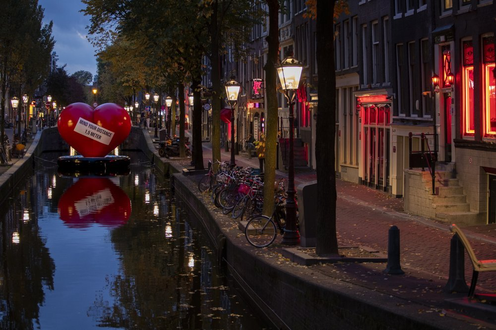 A Red Heart Carries A Social Distancing Message In A Near Empty Red Light District In Amsterdam, Netherlands, Friday, Oct. 23