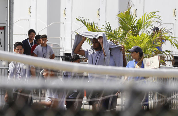 Migrant children walk outside at the Homestead Temporary Shelter for Unaccompanied Children a former Job Corps site that now houses them