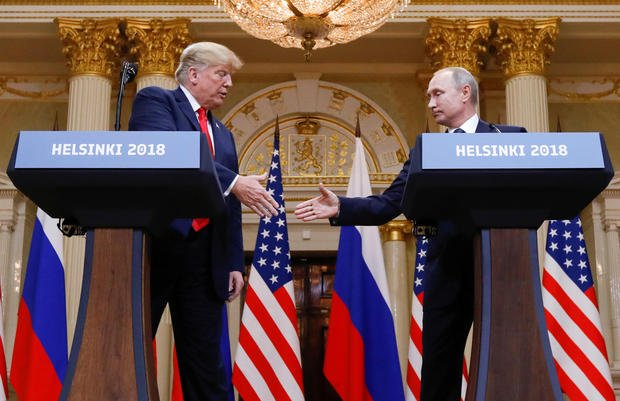 U.S. President Donald Trump and Russia's President Vladimir Putin shake hands during a joint news conference after their meeting in Helsinki