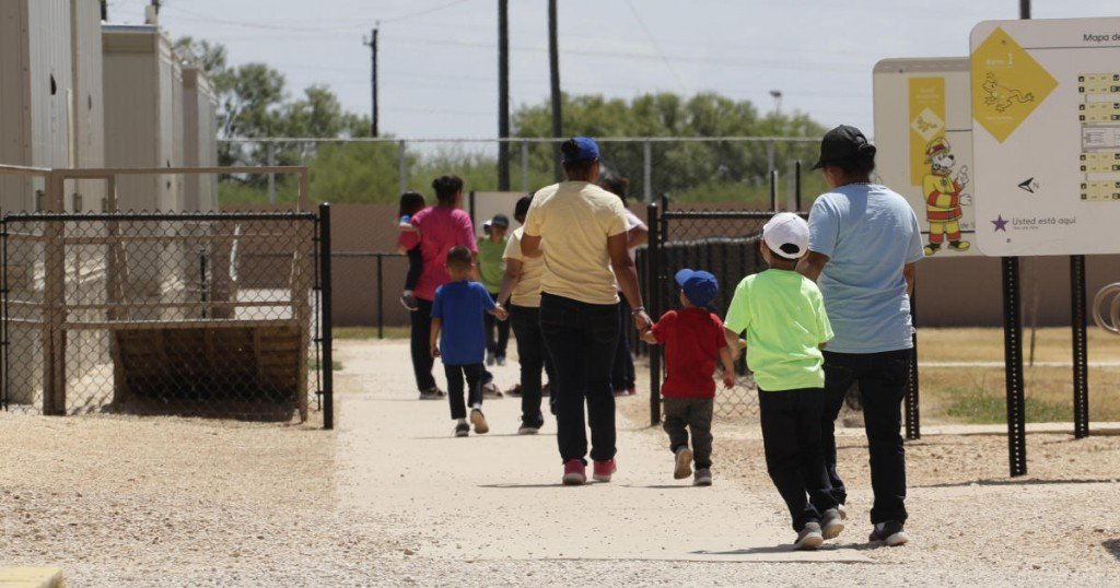 Immigrants seeking asylum leave a cafeteria at the ICE South Texas Family Residential Center
