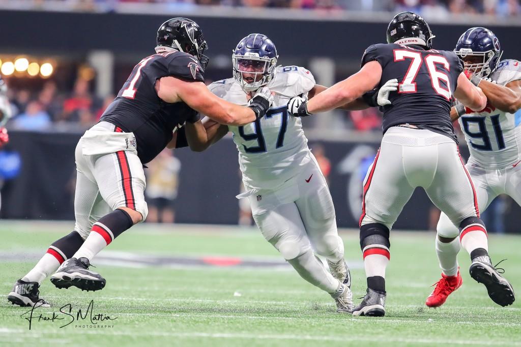 Titans DL Isaiah Mack blasts through Atlanta's offensive line.