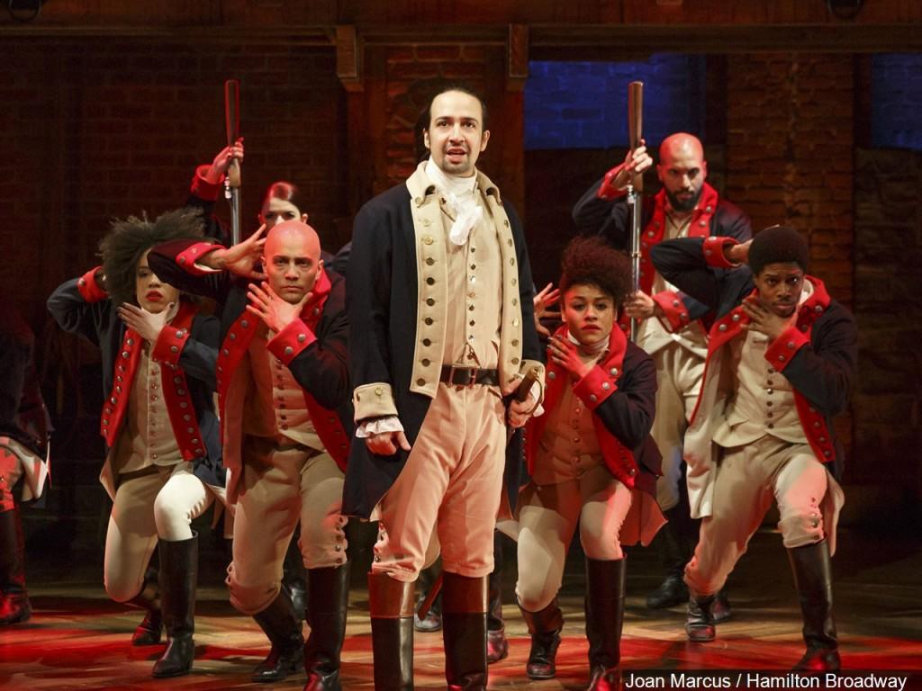 "Lin-Manuel Miranda (center) & the cast of the Broadway play ""Hamilton"""