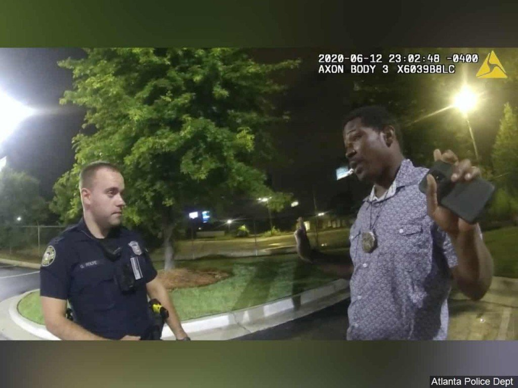 Body cam footage of Rayshard Brooks speaking with Officer Garrett Rolfe in the parking lot of a Wendy's restaurant in Atlanta