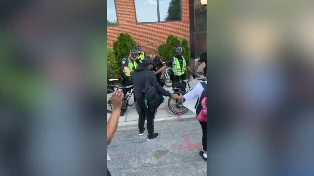 Nc: Police Officers Pray With Protesters