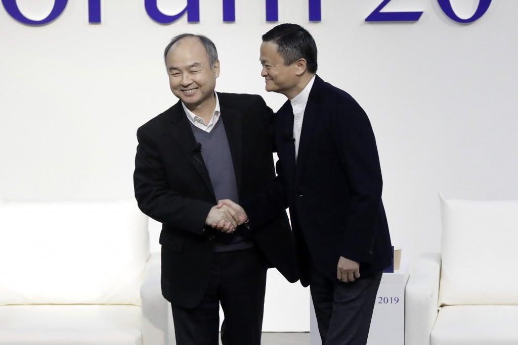 Softbank Chairman Masayoshi Son And Former Alibaba Group Chairman Jack Ma Discuss At Tokyo Forum