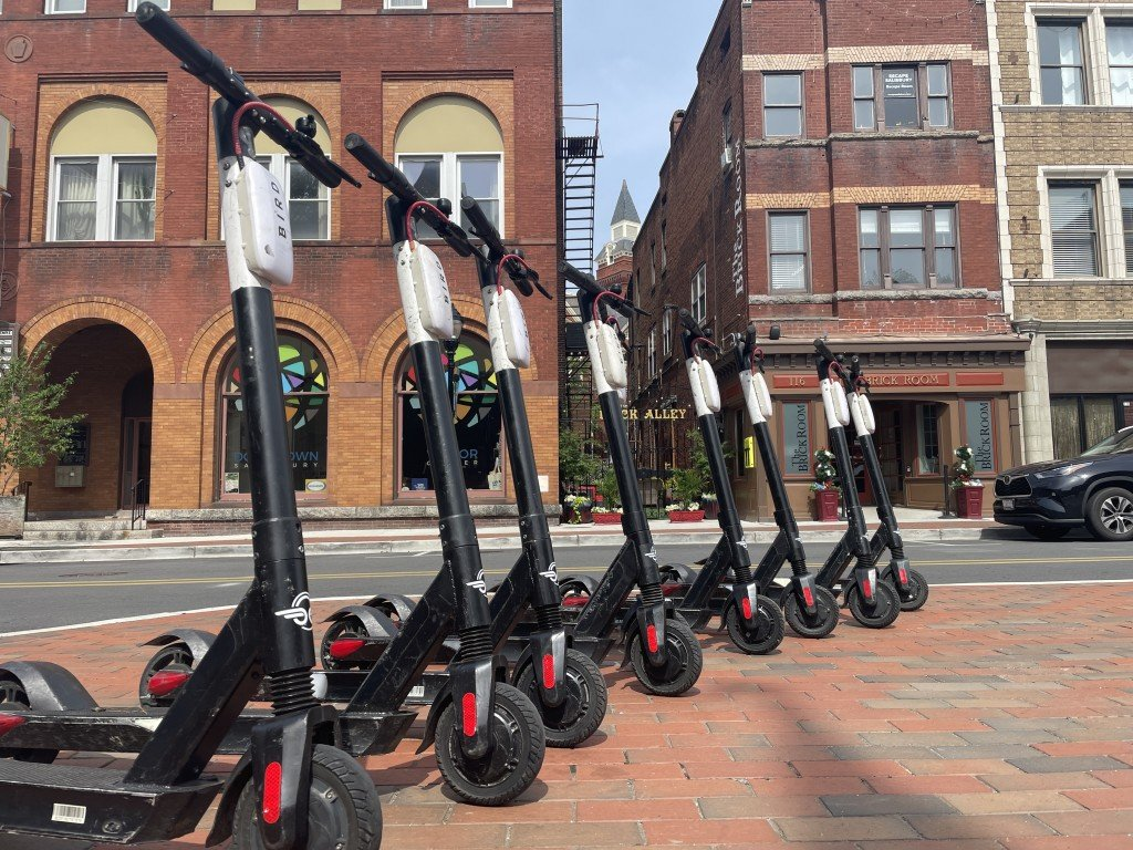 Scooters arranged in a line downtown