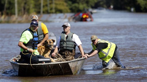 South Edgecombe Fire and Rescue workers rescue several dogs that were trapped in homes flooded by rising water from Town Creek in Pinetops