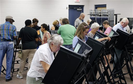 Voters fill the stations as hundreds came out on the first day of early voting at the Hope Mills Recreation Center in Hope Mills