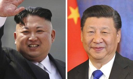 FILE - This combination of file photos shows North Korean leader Kim Jong Un