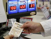 A customer is handed a Powerball ticket in Omaha