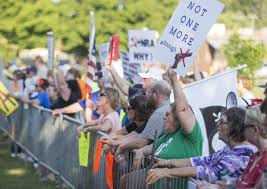 People protest in Murray where incoming NRA president Oliver North was a featured speaker at a GOP fundraiser 8-3-18.  Courtesy of the Paducah Sun