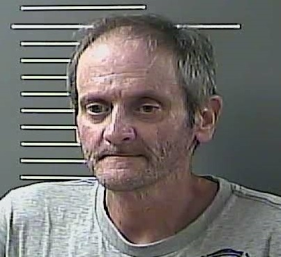 Accused of murder of Mike Jones in Johnson County.