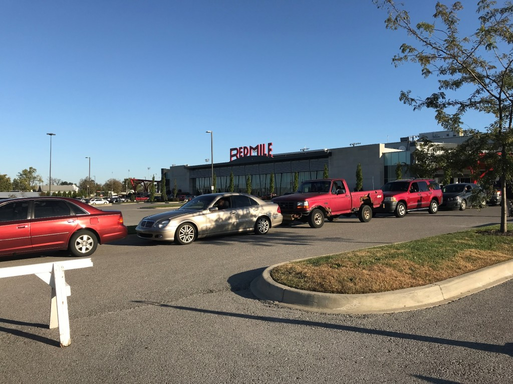 Cars line up at Red Mile to get free Mega Millions ticket vouchers.
