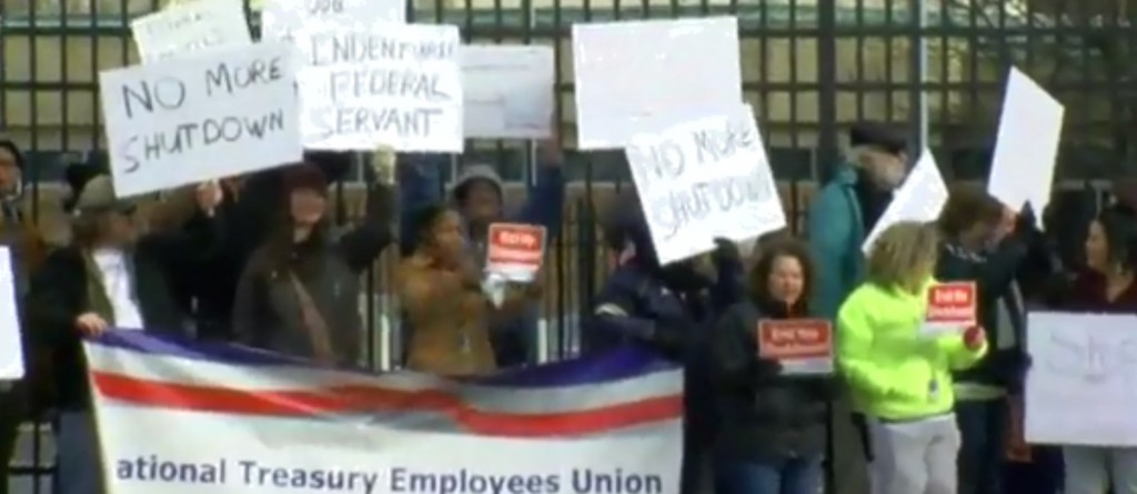 Federal employees demonstrate outside the IRS office in Covington