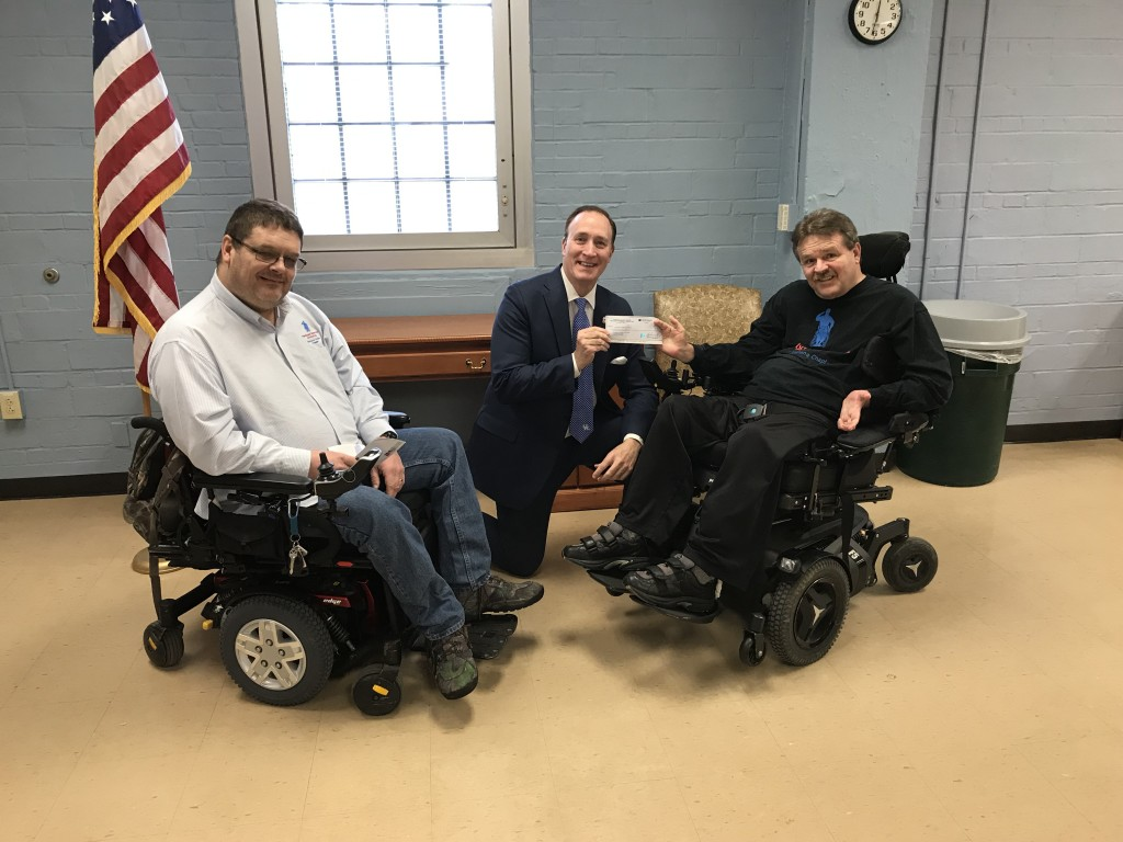 Kentucky-Indiana Chapter of the Paralyzed Veterans of America present check to Tom Kenny